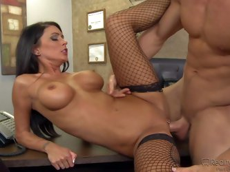 Jessica Jaymes with a milfy beauty with jet black hair, perfect long legs and amazing big boobs. She spreads her legs on a desk and gets her fuck hole