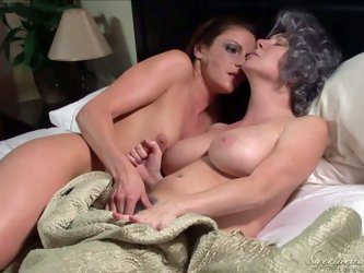 Rayveness and Samantha Ryan go to bed totally naked. Sexy assed brunette plays with woman's big boobs with desire. They fondle each other and sho