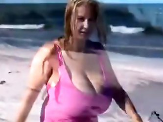 Amateur mature woman with huge boobs video. These are the biggest tits on the beach. See more mature amateur woman vidz on .