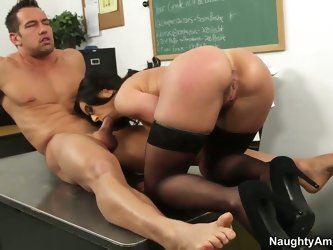 Johnny Castle and this gorgeous spectacled teacher Kendra Lust are fucking like never before. The hottie stays in stockings and high heels before gett