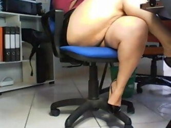 Hidden cam under desk in office spies on amateur secretary