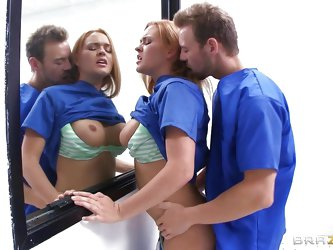 Krissy Lynn is a sexy nurse who's attending a seminar at a teaching hospital. She heads to the operating room to meet Doctor Erik Everhard fro a