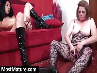 Two mature horny bitches are masturbating next to each other