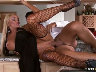 Sexy MILF Houston  in long black dress finds party boring  and looks for fun. She one is to suck cock and gets her pussy drilled deep. Unfaithful bust