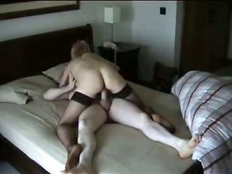My neighbor's cheating wife got caught on camera when she met her boyfriend in this hotel room. Wearing just net-stockings, she fucks this guy's d