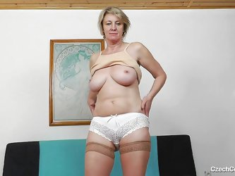 This dirty old Czech bitch shows off her saggy tits and pantyhose stockings. She licks her nipples and then leans back on the couch to spread open her