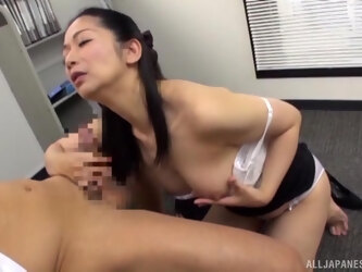 Japanese secretary drops on her knees to make him hard in the office