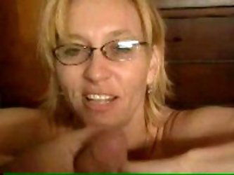 Her hands and mouth on a dick are the perfect cum-causing combination. This bespectacled MILF wholly deserves her moniker as the International Dowager