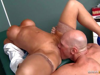 Arousing tanned experienced blonde doctor with huge firm balloons and bouncing delicious ass in high heels and white coat gets licked by bald horny Jo