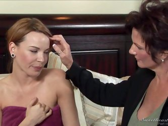 Alluring Dana Dearmond gets seduced by big titted mature brunette Deauxma. Experienced lesbian woman turns her on and they have lesbian fun in the bed