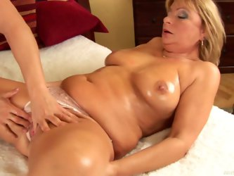 Sex hungry mature slut Rosalyn strips down to her lingerie for hot boy Jeremy N. He rubs her oiled big natural tits and her experienced snatch. He fuc