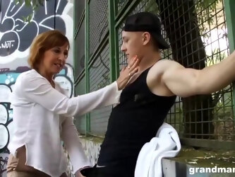 Mature woman is sucking dick in a public place and getting fucked hard, in return
