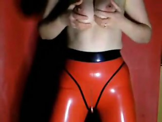 My mature wife milks her luscious breasts while wearing hot red leather pants in this homemade fetish porn video we made together.
