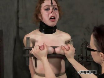 This domme tortures her slave by tying her to the chair and watching her squirm. Her tits are bound and squished flat by the pressure of the rope arou