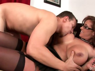 Four-eyed MILF Eva Notty in black nylons gets her massive tits eaten and her pussy fucked by her horny sex partner. She gets fondled and banged on the