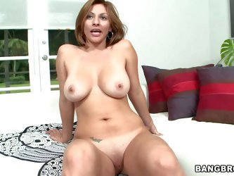 Lisa is a hot milf with huge boobs. Sexy middle aged latina poses naked showing off her big melons and nice pussy. Then she gets tongue fucked by hot