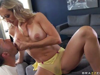 Brandi Love in a newly widowed milf with perfect tits! She is sex hungry. Woman takes off her bra and lets man play with her big tanlined tits. Then s