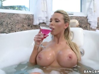 Amazing blond hottie Nikki Benz with gigantic boobs getting herself fucked hard after getting herself heated up in her bathtub while getting herself r