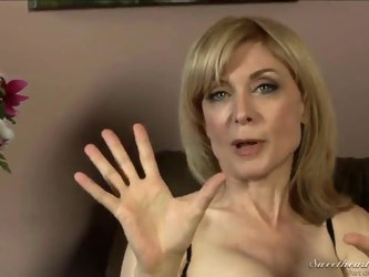 Nina Hartley might be mature, but she's still good looking in those sexy stockings and lingerie! Young Dia Lewa interviews her about her experien