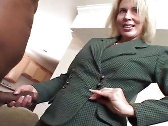 This blonde granny has stumbled into the ghetto, where she is going to suck on a great big black cock. She feels it with her hand and very quickly, sh