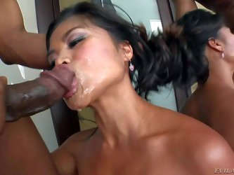 Nasty and arousing dark haired asian milf with nice boobs gets dominated by black dude Prince Yahshua and his friend Jonni Drakko in a hot deep throat