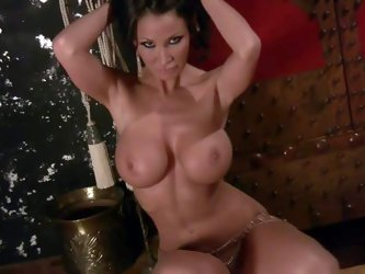 Sandee Westgate is a perfect bodied MILF. Gorgeous brunette poses totally naked. She's a stunningly beautiful lady with round ass, huge melons an