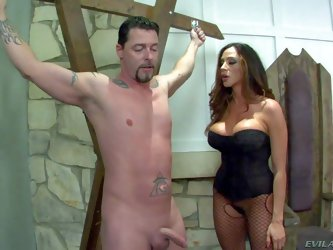 Ariella Ferrera is a big boobed milfy domina. She has a nice time playing with helpless naked man. Mistress in corset and crotchless pantyhose strokes