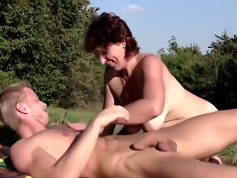 MTHRFKR - Big Titted Granny With A Hairy Pussy Fucks Grandson Outdoors
