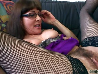 Alexandra Silk's sex partner loves her pierced hairy pussy. Mature brunette in mesh stockings gets her wet bush tongue fucked by curious dude. He