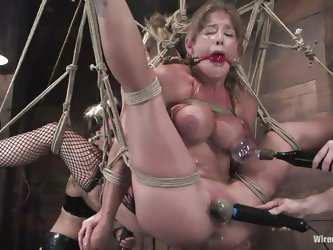 Sex slaves are tied together in rope bondage waiting eagerly to get punished. Tawni Ryden is a blonde milf who likes to take part of sex games with he