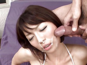 This sexy milf has a vibrator pressed against her hairy cunt by her man. He leaves it there as she writhes in pleasure. He jacks off his cock in front