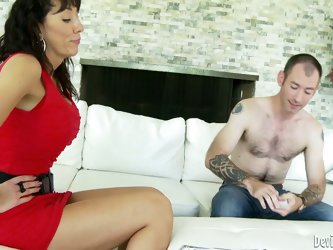 Brunette milf Alia Janine in short red dress plays strip poker with hot guy. And she bares it all in front of him. She bares her juicy tits and remoev