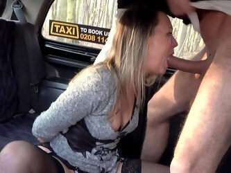 Wife rides dick on the back seat on her way to work