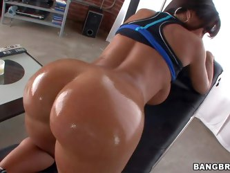 Curvy dark haired milf Lisa Ann with huge tits takes off her string thong and shows off her bare bubble butt. She displays her wet sexy bottom and the