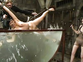 Maya has to endure some difficult water torture from the mean mistress. The slave is all tied up and submerged in a huge tank of water. The mistresses