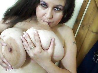This nasty Euro skank is in the nude and ready to show off her mature body. She plays with her huge tits and even, bites her nipples. What a bad girl