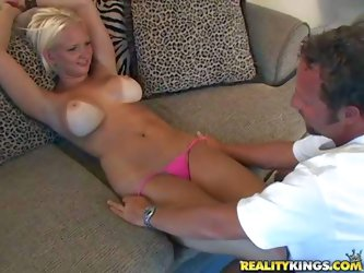 Short haired tanned blonde with round firm hooters and delicious ass in pink thong gets seduced by mature fucker and enjoys getting naked while making