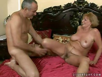 Horny and busty mature granny with a pretty hairy pussy gets nailed hard by a turned on grandad on the bed in their bedroom and get recorded with a ca