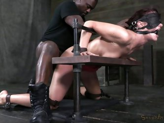 Whore Cici is experiencing the full wrath of her black executor. He squeezed her in a bondage device and now drills her pussy merciless. The black hun