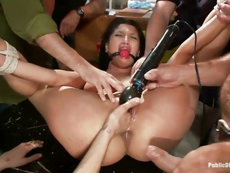 She's tied and dominated by these boys and another whore. Her shaved pussy is fisted hard and they use a vibrator to stimulate her clitoris befor