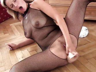 Mature blonde slut is very hot and horny. She is wearing sexy pantyhose and high heels while and lays on the floor, fucking her tight vagina with a bi
