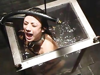 Nadia Styles is a beautiful milf who is locked up and thrown inside a water tank. Weights are attached to her feet and she is pulled down to the botto