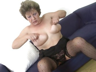 This dirty slut juggles her saggy boobs and then spreads her legs wide open to reveal her old pussy. She can even lick her own nipples. She sticks her