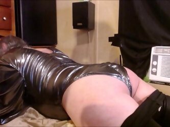 Tranny in silver bodeysuit humping satin pillow and sheets!