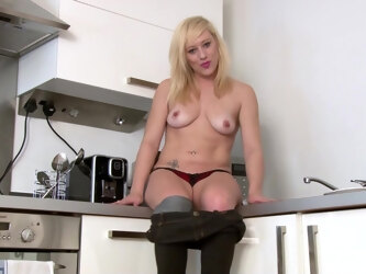 Skinny mature Axajay takes off her panties in the kitchen. HD