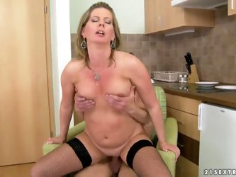 Horny mature blonde honey Laura Long enjoys in her passionate kitchen sex with her young lover, getting her shaved mature pussy licked and sucking a h