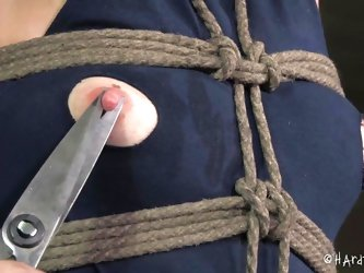 This dirty milf slave is tied up in rope and gagged so she can't scream or move while her master tortures her. She gets her nipples pinched with