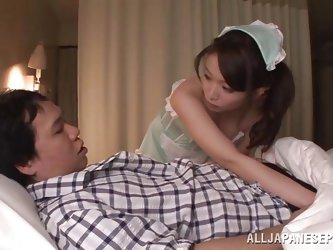 This cute Japanese babe is a sexy nurse and her patient is in need of some tender care. She pulls down his pajama bottoms and then plays with his cock