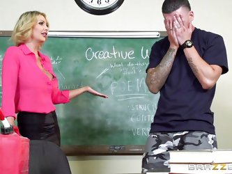 The atmosphere in the classroom is extremely intense. The blonde-haired imposing teacher seems to soften, when alone with a hot stud to whom she shows