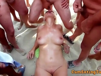 Experienced blonde woman with big tits and perky nipples is sucking many dicks in a row